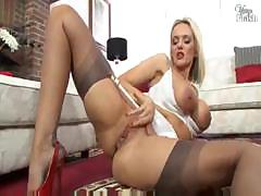 Busty blonde keeps her stockings on while she teases her man