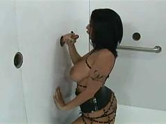 Black haired girl finds a nice hard cock to suck through glory hole