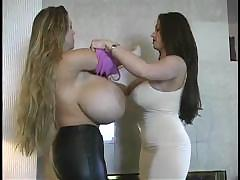 Two babes with totally enormous jugs get changed and play with each other