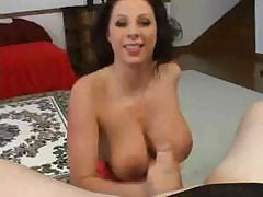 Gianna Michaels uses her tits and mouth to suck on a cock