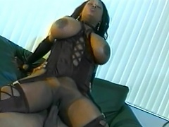 Share the moment with this voluptuous Black whore, exposing her huge...