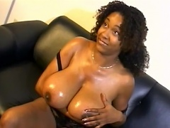 To prepare her mega boobs and her tight pussy, Chaka T applied...