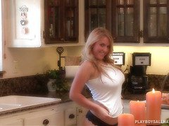 Plumpy and busty Ashley Gesell cooking in the kitchen