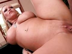 Busty blonde milf gets her beaver slammed by tattooed muscled stud