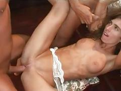 Tigth ass busty brunette in white stockings gets rammed in gang bang
