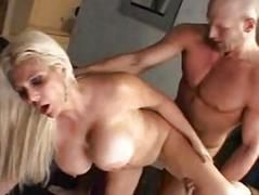 Pale blonde with massive knockers in boots gets rammed doggy style