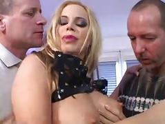 Blonde slut with large tits wearing red stockings enjoys in gang bang