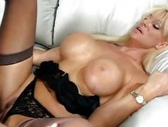 Busty blonde in stockings and black lingerie gets nailed hard