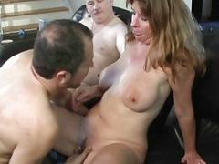 Brunette milf with big honkers sucks two stiff knobs