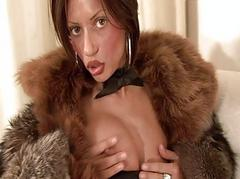 Busty brunette milf in furry coat sticks dildo up her honey pot