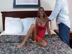 Heavy chested blonde milf in red dress gives head on bed