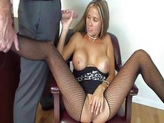 Busty blonde secretary in fishnet stockings gives head in office