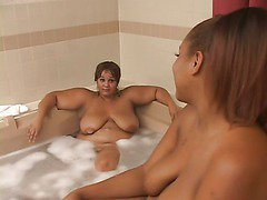 Two Huge Fatties Lick Each Other In Spa scene