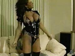 Sexy big titted brunette lady teasing in latex lingerie