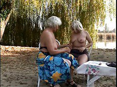 Blond Grannies Eating Hot Pussy Outdoors scene