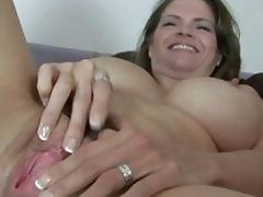 Busty June Summers plays with her ideal pussy
