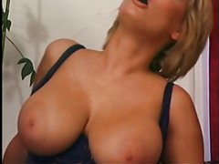 Shorthaired blonde cougar with huge tits hit by younger cock