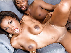 Ebony hottie gets her boobs creamed