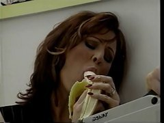 Hot brunette entices guy with banana then sucks his cock
