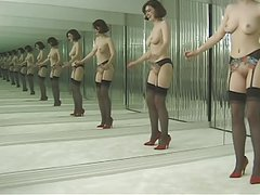 Slut in stockings strips before dressing room mirrors