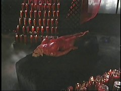 Fetish slut gets covered in hot wax
