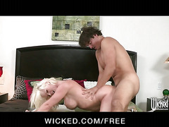 Big-tit blonde cougar picks up a young stud to suck & fuck