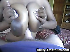 Ebony Lola is doing blowjob and horny titfuck