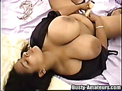 Latina is masturbating and giving titjob in this video