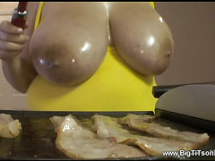 Teen with huge natural 38F breasts cooks bacon and eggs