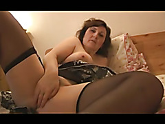 Busty attractive Milf posing and stripping