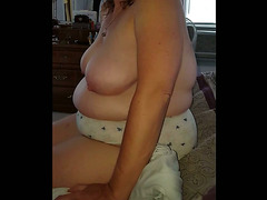sitting on the bed, big tits, hairy bush