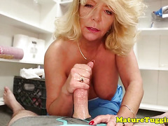 Busty mature tugging stepsons cock