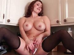 Busty redhead MILF babe toys her fanny in the kitchen