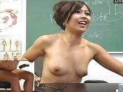 Naughty Asian teacher toys her hungry cunt