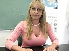 Blonde mature teacher shows off her impressive cleavage