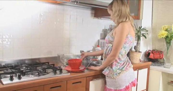 Super hot busty blonde doing the dishes