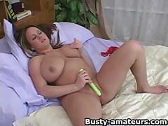 Big-breasted Brandys rubs her clit and shoves green dildo in her shaven pussy