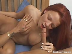 Red-haired cutie gets dick into her mouth and slides sweetly back and forth