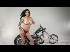 Tera Patrick posing topless by the bike