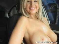 Flashing her big tits in the car