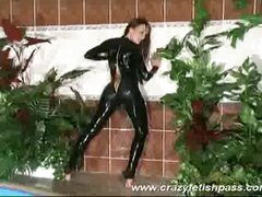 Hot rubber babe streching legs