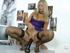 Sultry solo girl rides a big dildo