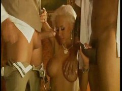Blonde with bleached hair takes two dicks