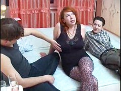 Redhead in hot stockings does threesome