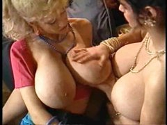 Two girls with really big tits go lesbian