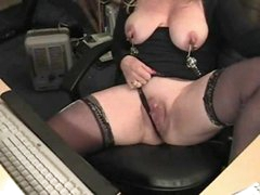 Mature in nipple clamps at her desk