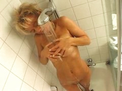 Blonde showers and sucks his cock